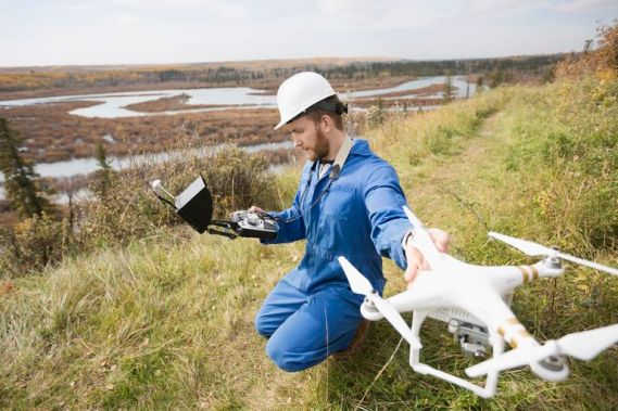 surveyor-with-drone-equipment-on-hillside-686720977-5887f25b3df78c2ccdce9a66